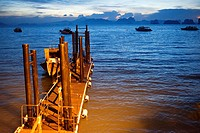 Six Senses Resort, Koh Yao Noi, Phang Nga Bay, Thailand, Asia. Boat in the harbour waiting for Sunrise Picnic breakfast on a deserted Island in Koh Ho...