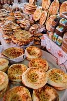 Tables with fresh Kazakh Nan bread in Shymkent Central Market Kazakhstan.
