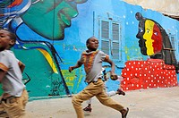 collective mural painting in Medina district, Dakar, Senegal, West Africa.