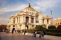 View to the Palacio De Las Bellas Artes-Palace Of Fine Arts with people sitting in the foreground, Mexico City, Mexico, Central America