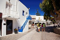 Tourists walking in the town center of the Naoussa village, Paros, Cyclades Islands, Greek Islands, Greece, Europe