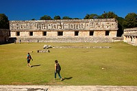 Tourists in front of the Quadrangle Of The Nuns, Uxmal Ruins, Yucatan Province, Mexico, Central America