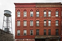 Old Tenement Store and Apartment Buildings in the Greenpoint Section of Brooklyn, NY, USA.