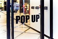 """""""""""""""""""""""Pop Up"""""""" Sign Applied to the Entry Door of a Pop-Up, Temporary Store in Manhattan, New York City."""