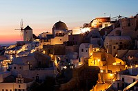 View to the windmill, church and Cyclades houses in Oia village after the sunset, Santorini, Cyclades Islands, Greek Islands, Greece, Europe