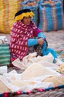 Indigenous woman selling rice at the open-air market in Pisac, Valle Sagrado, Cusco Region, Peru, South America