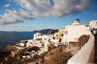 Blue domed church looking out to the Aegean Sea in Oia village, Santorini, Cyclades Islands, Greek Islands, Greece, Europe