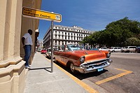 Vintage American car used as taxi in front of the Hotel Parque Central in Center Havana, La Habana, Cuba, West Indies, Central America