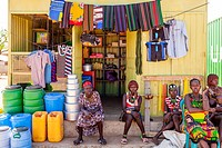 Hamer People Sitting Outside A Colourful Shop In The Village Of Turmi, Omo Valley, Ethiopia.