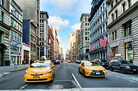 Looking North on Fifth Avenue, Manhattan, New York City, from East 18th Street. Two Yellow NYC Taxicabs appproaching the intersection.