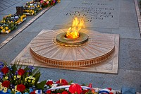 Unknown Soldier memorial flame under Arc de Triomphe in Paris France since 1921.